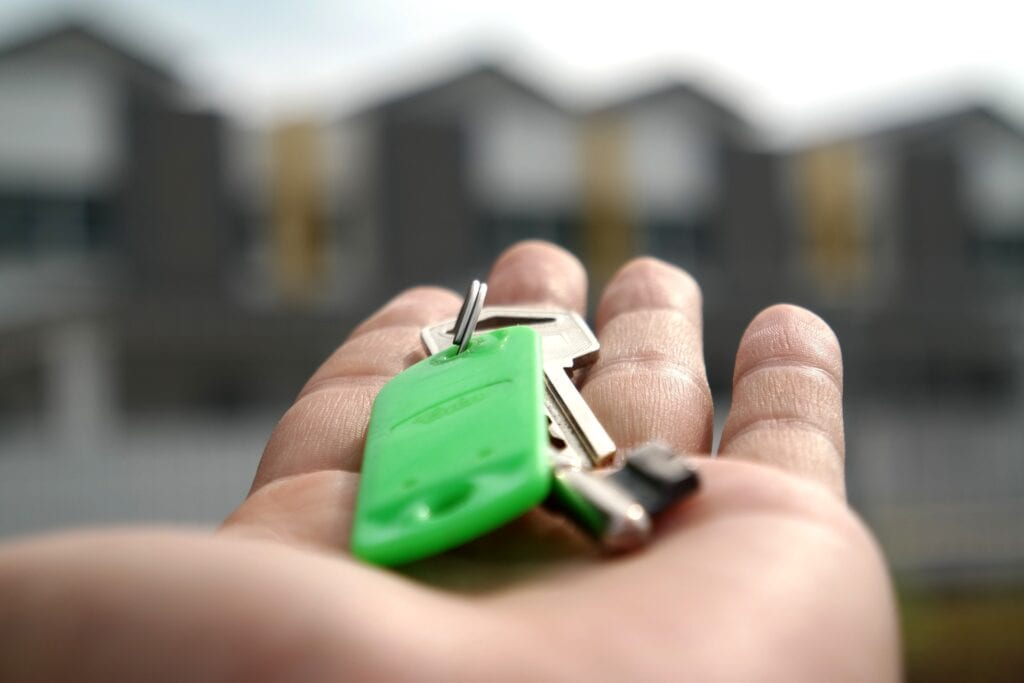 Hand Holding Keys For Selling A House