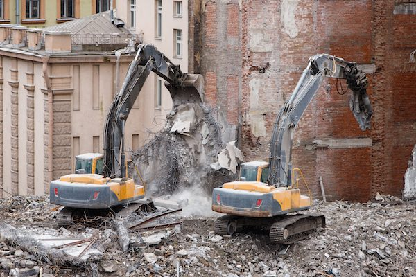 Building Of The Former Hotel Demolition For New Construction, Using A Two Special Hydraulic Excavator-Destroyer. Complete Mechanized Demolition Of A Building. Reinforced Concrete Structures.