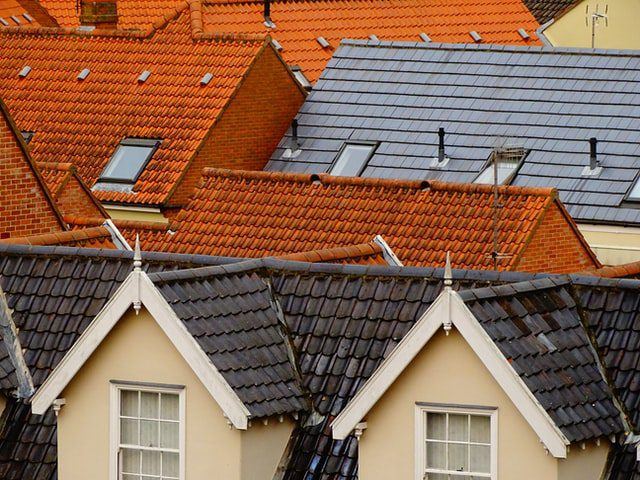 Different Colored Roofs, Black, Grey And Tan.